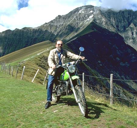 Ralph Walker on Trail Bike in Switzerland, with second photo in background which can be viewed in Netscape but not in Internet Explorer